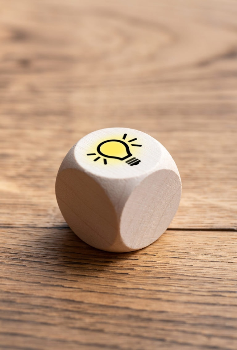 cube with a lightbulb symbol on wooden background